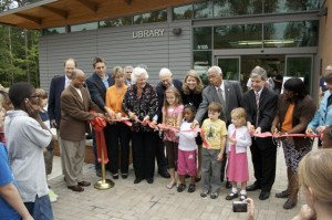 Community Children as well as those involved in the opening of the new library cut the ribbon.