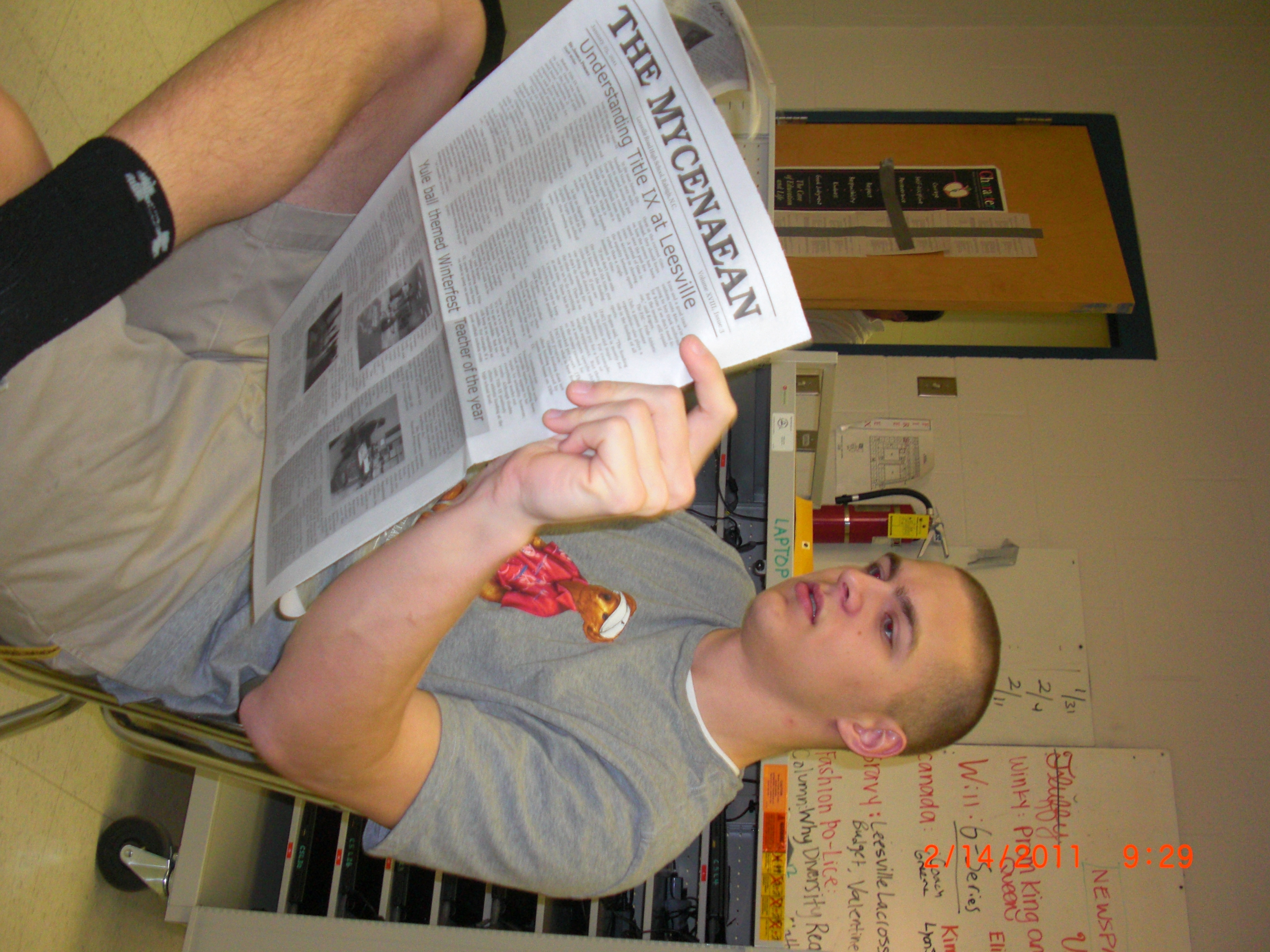 jon reading newspaper for my article about newspapers