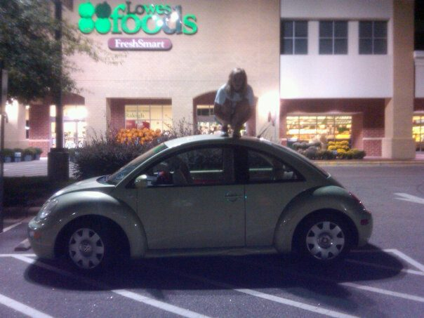 "Mary Kate Bowers ""owls"" on top of a car in a Lowes Foods parking lot. She spent a Friday night owling in random places with friends."