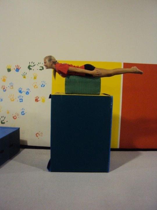 Cami Burns, senior, works hard at gymnastics practice.