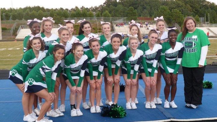The Leesville varsity cheerleaders pose in uniform before a football game.
