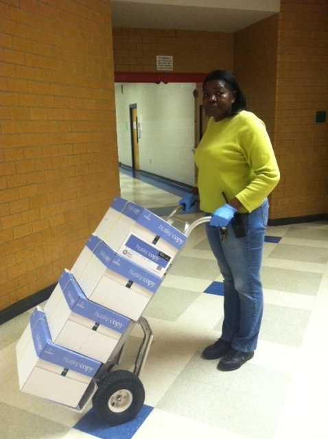 Mrs Williams brings supplies to a meeting. This is one of her many morning duties that she does with a smile.