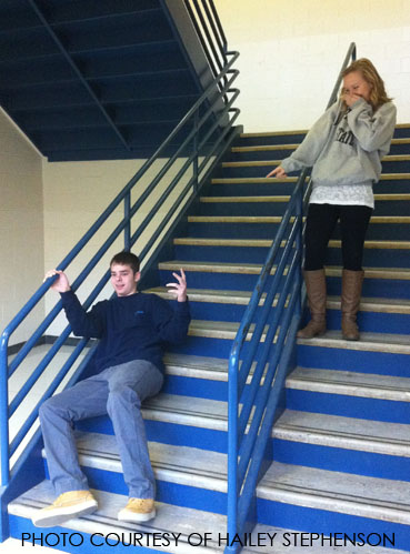 As Nicholas Mancini, junior, falls down the stairs, Mackenzie Robinson, junior, laughs and points. Many of the students at Leesville laugh at one another whenever they do something embarrassing.