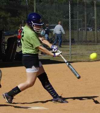 Erin James, sophomore, is practicing her batting skills. The Pride's offensive has contributed to a successful season.