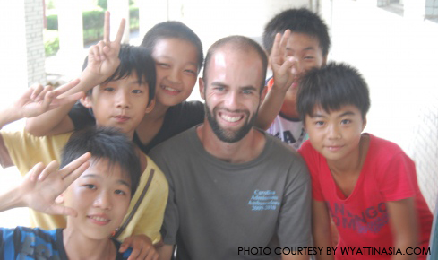 "Wyatt Bruton poses with his ""Teach for China"" students."