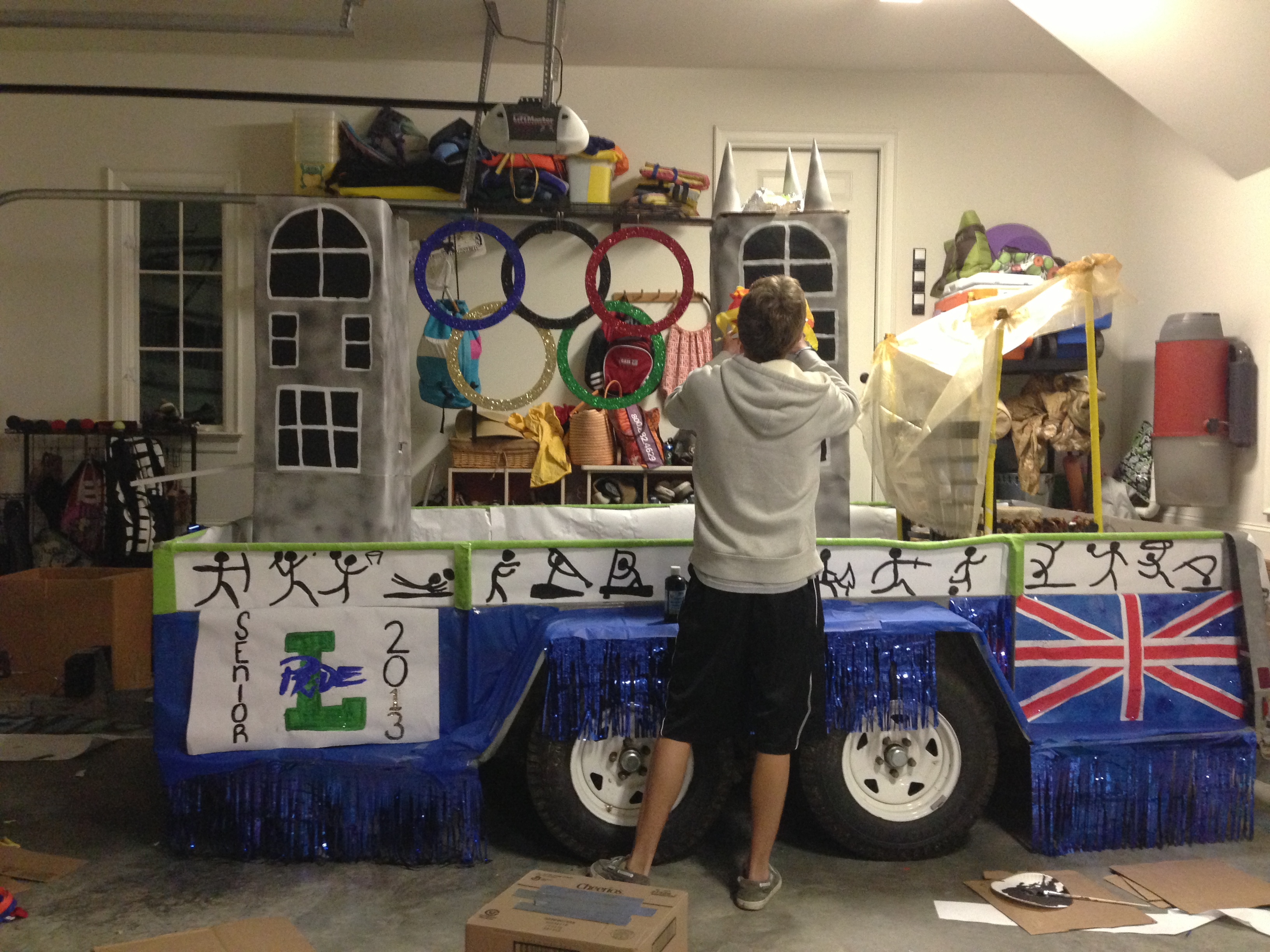 Preston Nix, senior, goes to work on the Senior Class Council float. Students spend hundreds of dollars on their homecoming floats each year.