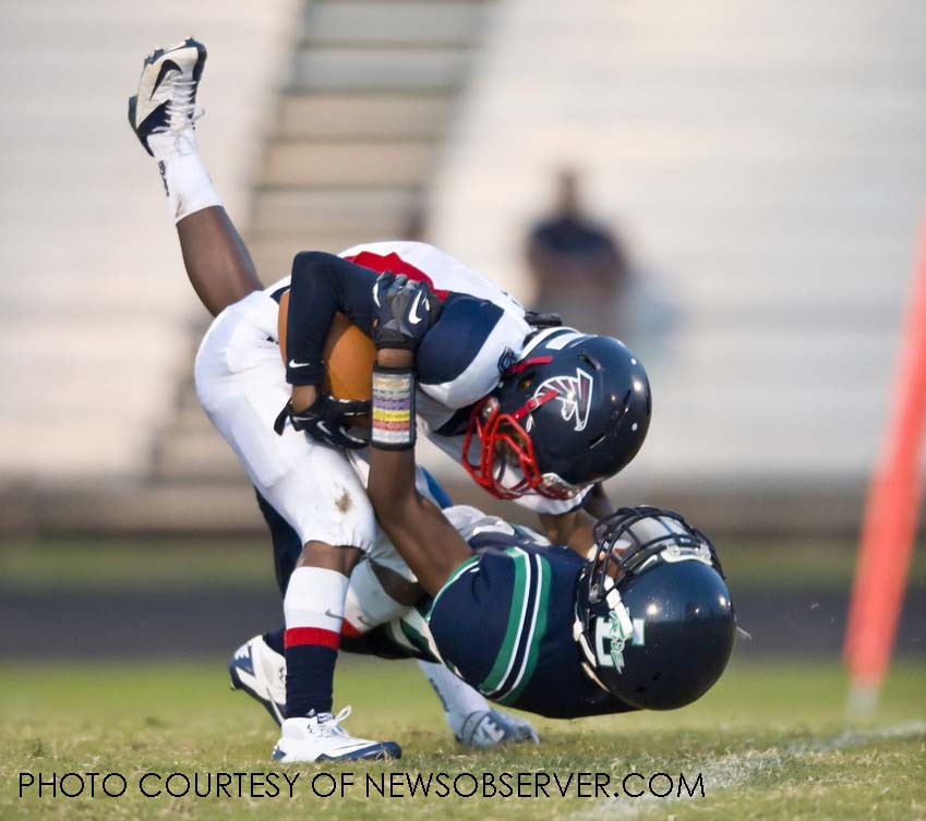A Leesville football player collides with a running back. Hits such as these can cause major concussions and brain damage.