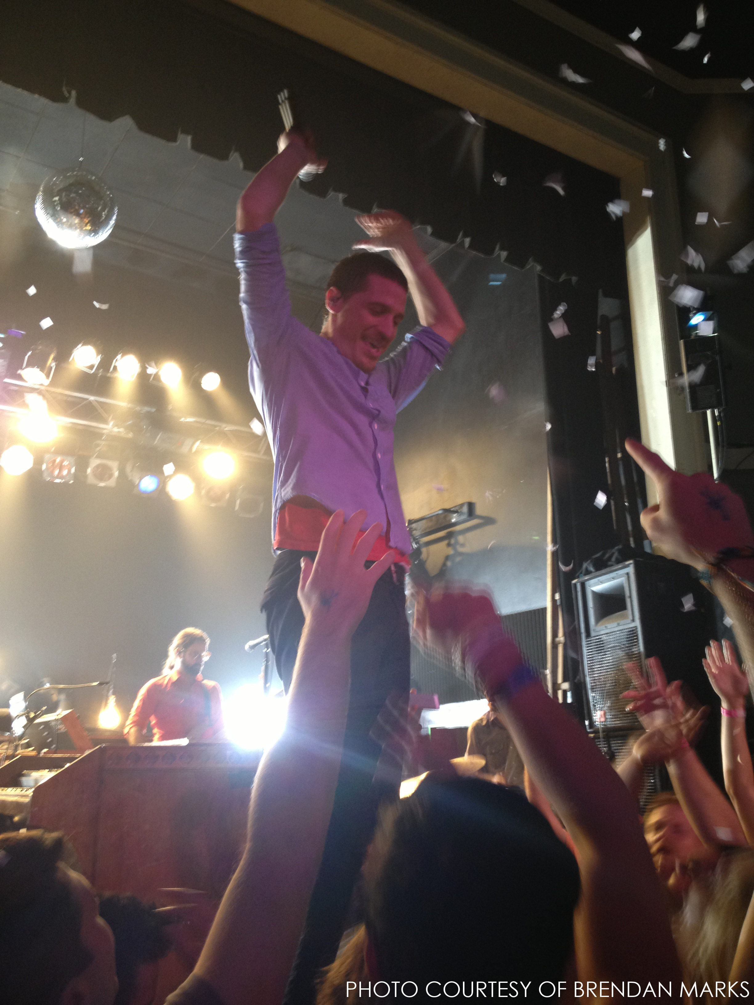 Meany after the final song of MUTEMATH's encore. Confetti cannons blew everywhere and lights blasted through the theater as Meany threw his hands up in celebration.