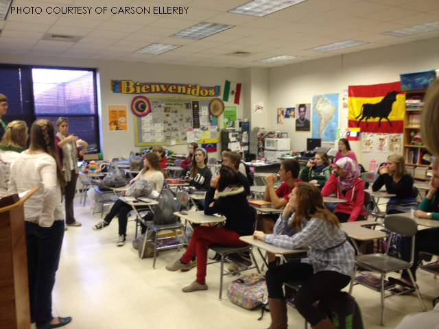 Above is an image of a Spanish club meeting. The Spanish and Latin clubs are working together to bring winter clothes to the less fortunate.