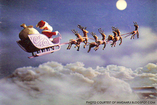Santa Claus flying through the air, as depicted by the movie Rudolph the Red Nosed Reindeer. While some worry that lying to children about Santa Claus hurts kids more than it helps them, research proves that kids who believe in Santa are better at understanding others' viewpoints than kids who don't believe.