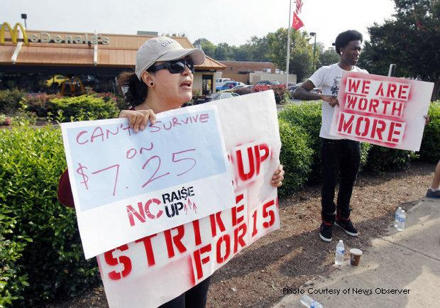 Lucia Garcia and Cory Munlyn are two of the many Triangle fast food workers seen striking outside of a McDonald's in Durham. Several restaurants across the country were closed due to walkouts.