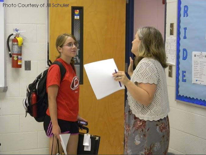Mrs. Mosley, the advisor of Model UN, talks to Sara Mirek, a Leesville student. The club provides students with the opportunity to develop skills and make new friends.