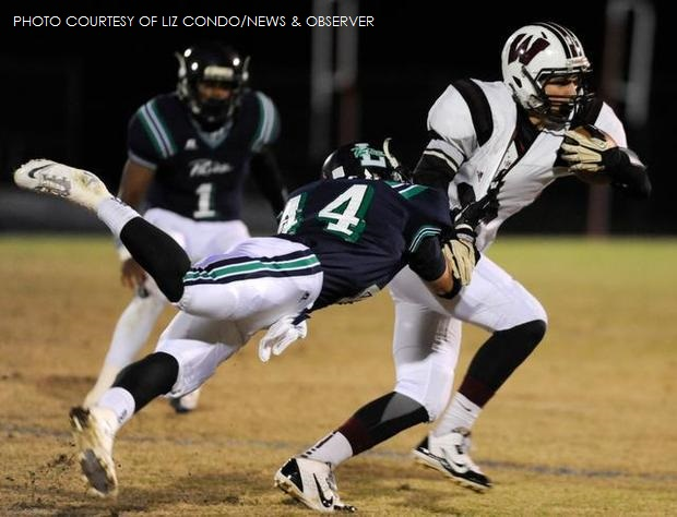Evan Braband, Wakefield quarterback, fights to escape a tackle from Mike Dehaney, Leesville junior. Brabrand's heroics led the Wolverines to a stunning 34-31 win over the host Pride in the Cap-8 championship.
