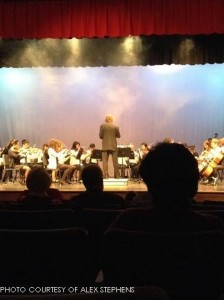 """Mr. Stiles conducts both the string and chamber orchestras in their opening number, """"I'm Shipping Up to Boston."""" All orchestra members processed in dramatically, carrying their instruments."""