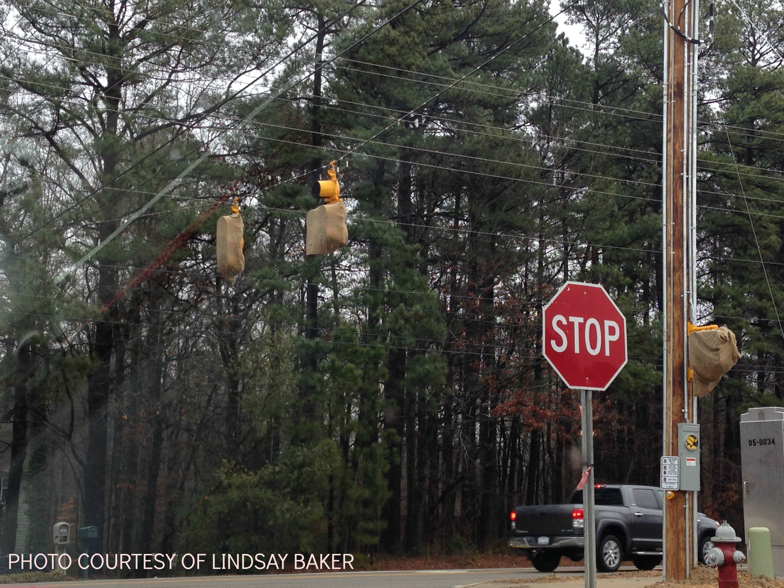 A photograph of one of the three new stop lights at the intersection of Leesville Road and Fairbanks road. The new stop lights are being installed because of how difficult and dangerous it is to turn left onto Fairbanks Road.