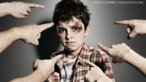 This bruised child with fingers of blame pointed at him represent the distorted relationship between bullies and their victims. The violent predator-prey interaction between both parties create bullies lacking empathy and victims who internalize bullying as a character flaw.
