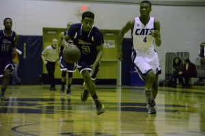 Alex Hunter (left) leads the fast break against Millbrook. The freshman surprised many with his play.