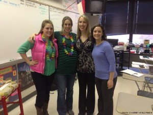 Señora Sollie (second from left) is surrounded by her friends and fellow language teachers Señorita Daniel, Señora Barnwell and Madame West. Everyone was excited to find out Sollie's baby girl, Addison Palmer Sollie, was born on Valentine's Day.