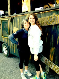"My mom and I pose in front of the ""Who Dat Shack"" float that we rode on. The theme for the parade, Caesar, was ""Game Time"" and it began at 6 p.m. on Saturday, February 22."