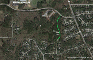 The current satellite of the Leesville Park and the surrounding roads, with the trail path outlined in dashed red. More trails are planned for the years ahead to circle through the currently undeveloped green space.