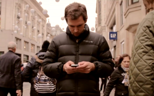 We look down at our phones most frequently in public places where we are amongst strangers. It's almost of the norm now to go for a stroll in a city and not make any face to face communication.