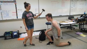 Juliet Simpson, current President and senior,  inducts next year's President and junior, Alec Way. The tradition is for the gavel, with which the President leads meetings, to be passed from one President to another.