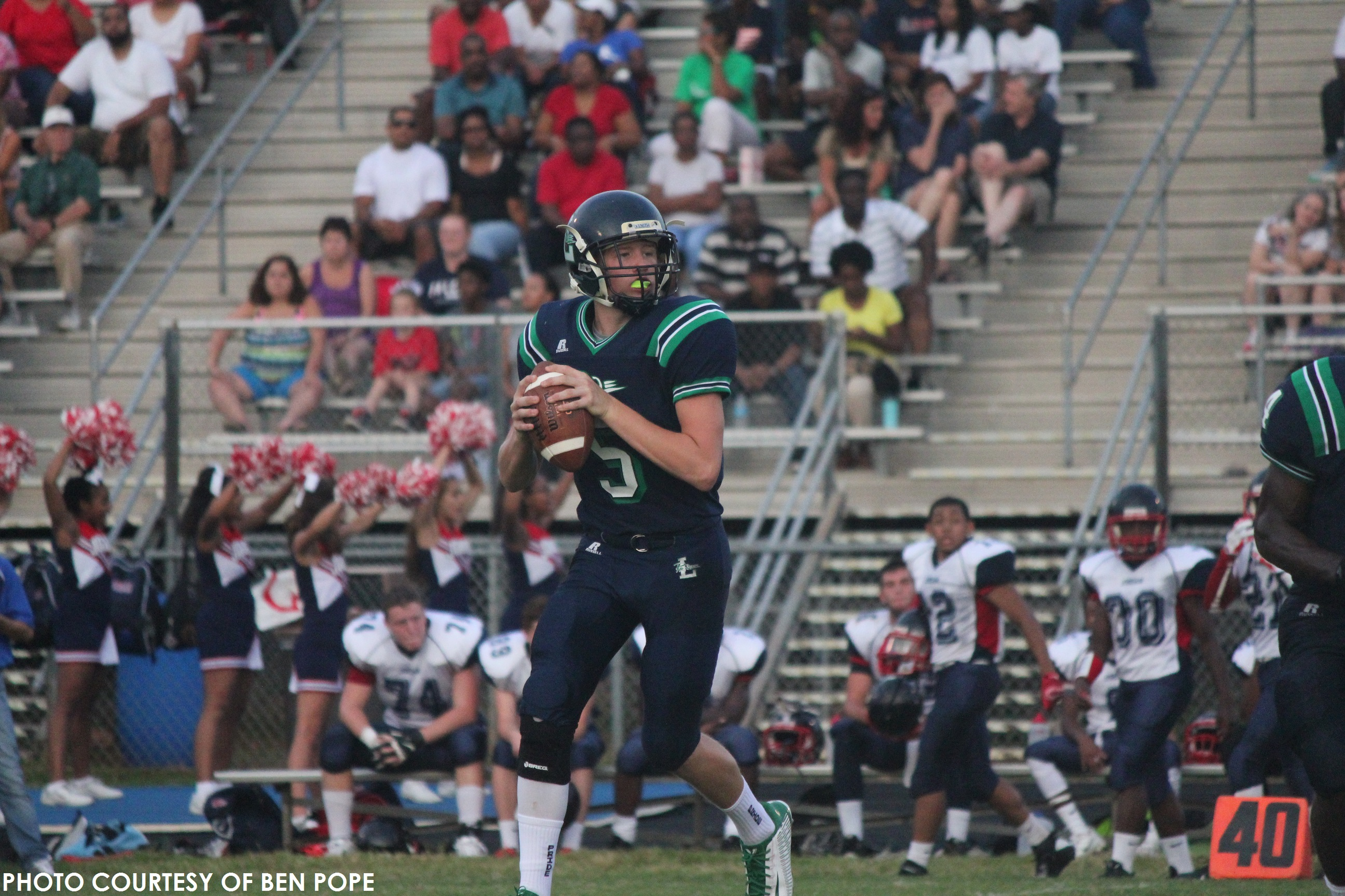 Clay Vick, junior quarterback, drops back to pass and looks for a target. Vick completed over 80% of his attempts for three touchdowns.