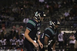 Clay Vick (#5, left), junior quarterback, and Mike Dehaney (#4, right), senior running back, prepare for a snap. Vick threw for 172 yards while Dehaney rushed for 141 as Leesville defeated Athens Drive 27-16.