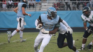 Panther Creek running back Addison Pinkney is hit by a Leesville defender during the first half of Friday's game. Pinkney accounted for 74 yards as Panther Creek won, 27-0.