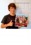 Jordan Brady holds one of his many prized vinyl Beatles albums.