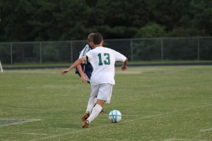 Michael Spear, Leesville's midfielder, dribbles past Lee County defender on Monday night's game. The Pride went on to win the game 4-0.