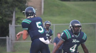 During a game earlier this season, Vick (#5) throws a screen pass to Richardson (back) while Dehaney (#4) looks for a man to block. The trio of stars helped Leesville's offense earn over 400 yards against Enloe.
