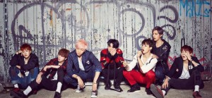 """(left to right) J-Hope, Jin, Rap Monster, Jungkook, Jimin, V, and Suga pose for the concept photo for their new single """"War of Hormone."""" The song was previously released on their album Dark and Wild."""