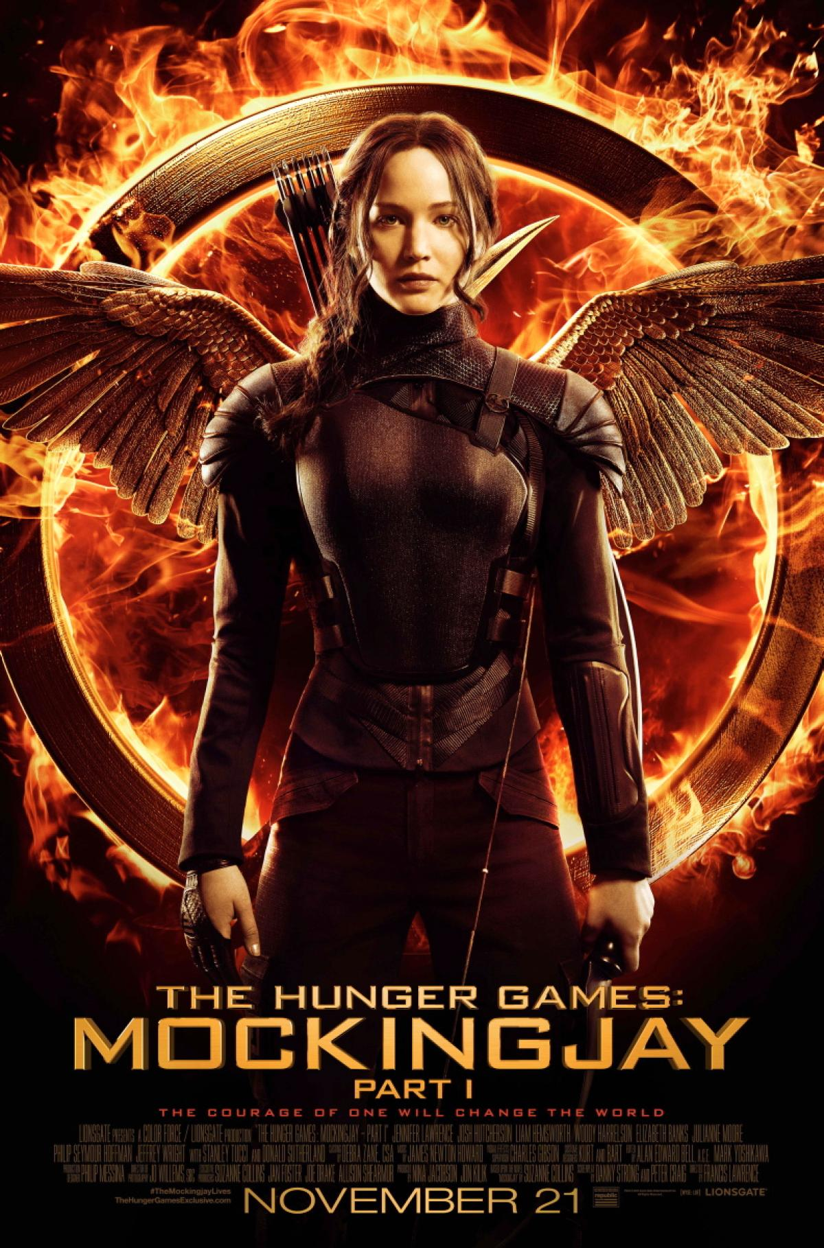 The movie poster for The Hunger Games: Mockingjay - Part 1 has the symbolic mockingjay pin in the background. The pin also appears throughout the movie and after the end credits, which begin by dedicating the movie to actor Philip Seymour Hoffman, who passed away before the film premiered.