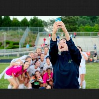 Cade takes a selfie with last year's women's soccer team after winning the first playoff game. She always brings enthusiasm and excitement to every game.