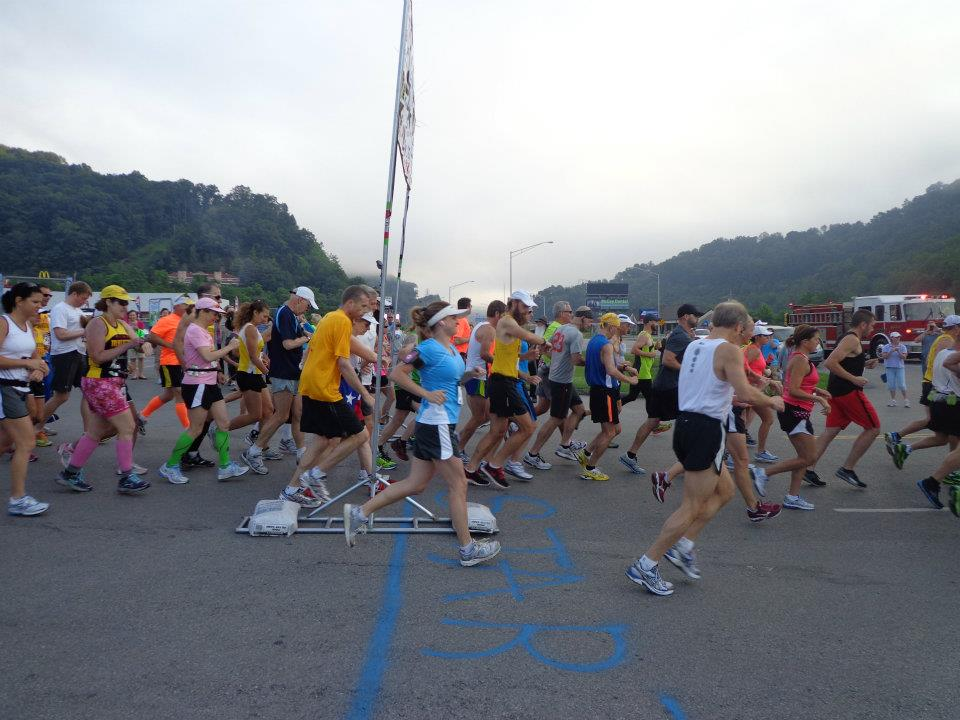 Mrs. Fishbane (in the blue shirt) takes off from the starting line in the Hatfield and McCoy Marathon up in West Virginia. Running has become a growing trend and hobby amongst all ages.