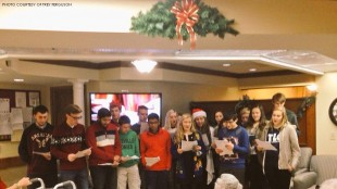 Executive Council members carol to the residents of Springmoor retirement community. 18 students, as well as, Mr. Ferguson and Ms. Mayfield, council advisers attended the caroling.