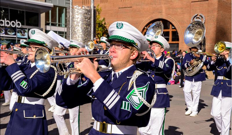 Bradley Turner, senior trumpet player, marches with the band down Fayetteville St.