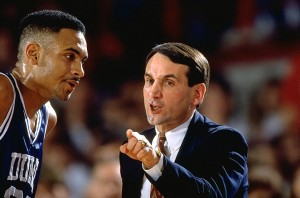 Coach Mike Krzyzewski instructing Grant Hill, former Duke and NBA player. Coach K won his 1,000th game Sunday and now holds a record of 1,000-308.