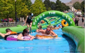 This photo features the 1,000 foot waterslide in action. Slide the City is traveling to 190 cities across the United States this year.
