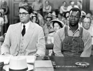 Atticus with Tom Robinson in court in Maycomb. This is a quintessential image displaying Atticus' respect for all mankind.