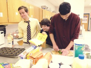 ProStart crew gets busy preparing ingredients for their big event. All food made for the event was done in class.