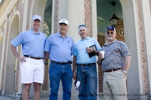 Chip Stone, Ron Lowry, Louis Newton and Cramer Boswell, UNC alumni and football players in the late 1960s, pose for a picture at the base of the bell tower. Stone was a three sport athlete at UNC; he also played soccer and baseball.