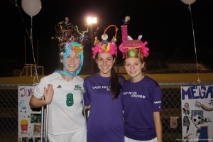 Seniors Jordan Mareno, Caroline Smith and Megan Purich (left to right) pose for a picture in their senior crowns after the game. All three players have lettered for three years.