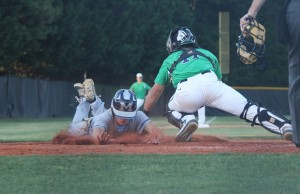 Millbrook scores one of three runs in the 3rd inning past the reaching tag of Leesville catcher Jack Conley. Millbrook rode the hot start to a 4-2 win.