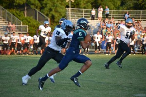 Jordon Moore,Leesville wideout, sprints past a defender in the first quarter. Despite the loss, Moore would finish with 13 receptions, 122 yards, and a TD.