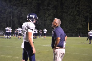 Senior quarterback Clay Vick receives instruction from Coach Brad Wilson after a deep incomplete pass. The score at the time was 28-6 Leesville, and the Pride would go on to win comfortably.