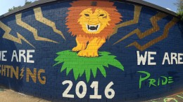 The senior wall displays a creative design, making it an empowering statement on school grounds. A group of seniors worked strenuously for two weeks to complete the wall. Photo Courtesy of Jonathan Spear.