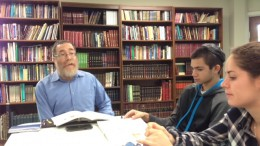 WCPSS high school students, Eytan Shpurker and Jenni Goldstein, listen to Rabbi Pinchas Herman as he explains Jewish traditions at the Chabad of Raleigh. These students value the importance of learning about the customs and traditions of Judaism.