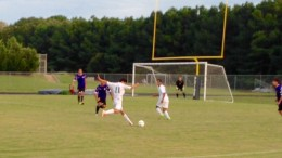 Evan Dezzutto, left, shoots the ball as Alyddin Darar turns and watches. The Pride took advantage of their limited opportunities on goal against the Caps.